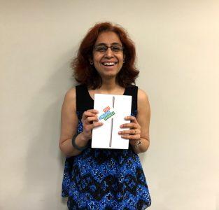 Charuta Kulkarni with her raffle prize