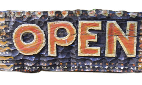 An Open sign from a rustic cafe
